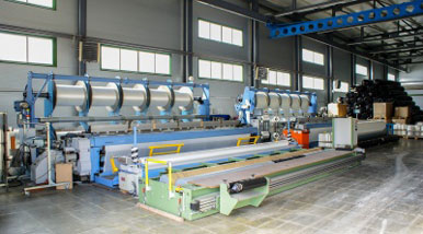 Production of high strength woven PP and PET geotextile